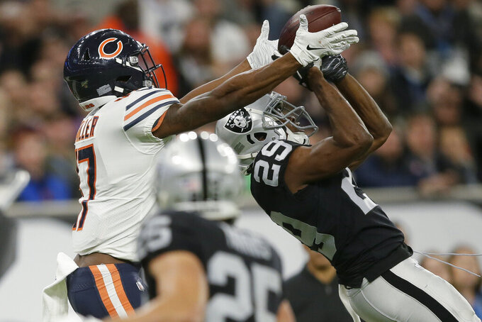 Chicago Bears wide receiver Anthony Miller (17) makes a catch against Oakland Raiders free safety Lamarcus Joyner (29) during the second half of an NFL football game at Tottenham Hotspur Stadium, Sunday, Oct. 6, 2019, in London. (AP Photo/Tim Ireland)