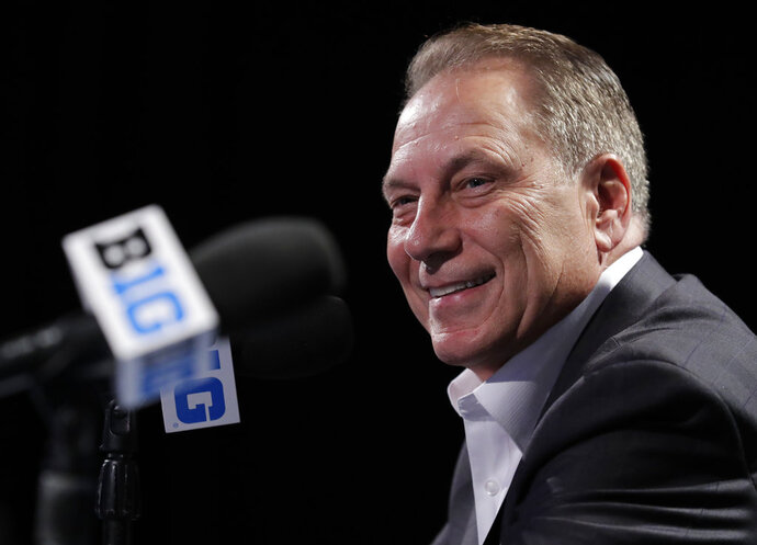 Michigan State head coach Tom Izzo smiles as he speaks at a press conference during Big Ten NCAA college basketball media day Thursday, Oct. 11, 2018, in Rosemont, Ill. (AP Photo/Nam Y. Huh)