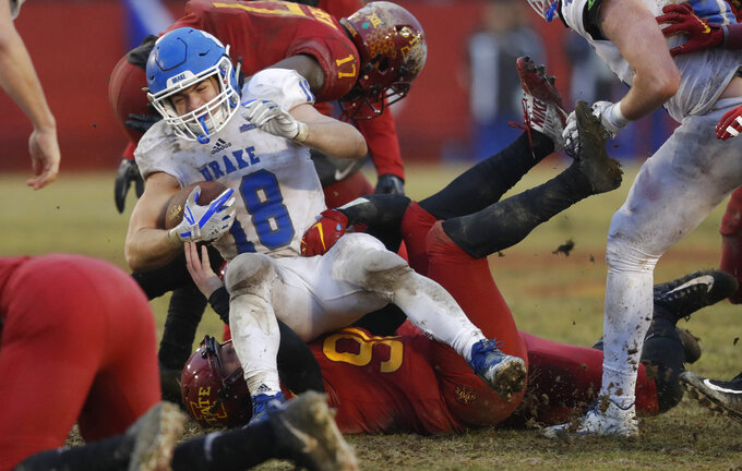 Drake's Braeden Hartwig (18) is tackled by Iowa State kicker Connor Assalley while returning a kickoff during the second half of an NCAA college football game, Saturday, Dec. 1, 2018, in Ames, Iowa. Iowa State won 27-24. (AP Photo/Charlie Neibergall)