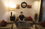 Karan Murgai, an IT management consultant for a multinational based in Dallas, sits in his Delhi house, in New Delhi, India, Tuesday, June 30, 2020. Murgai came to Delhi in March this year after his father died. Murgai and at least 1,000 others like him, whose U.S. visas are tied to their jobs in the U.S., are now stranded in India, after an executive order signed by President Donald Trump that suspends applications for H-1B and other high-skilled work visas from abroad. (AP Photo/Manish Swarup)
