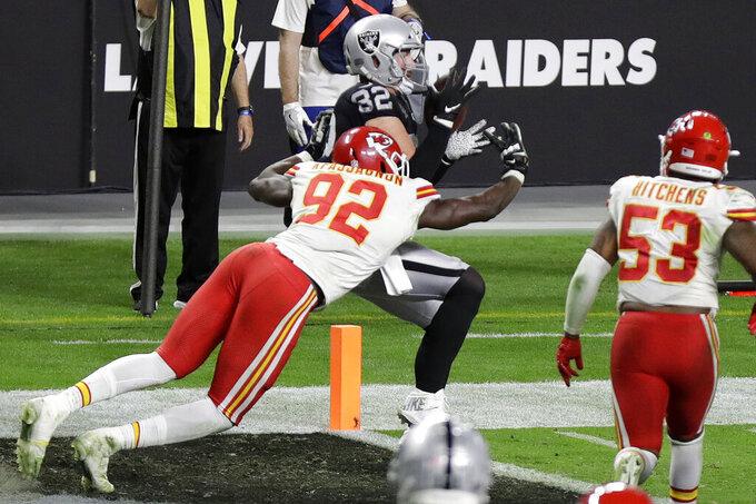 Las Vegas Raiders tight end Jason Witten (82) catches a touchdown pass against Kansas City Chiefs defensive end Tanoh Kpassagnon (92) during the second half of an NFL football game, Sunday, Nov. 22, 2020, in Las Vegas. (AP Photo/Isaac Brekken)