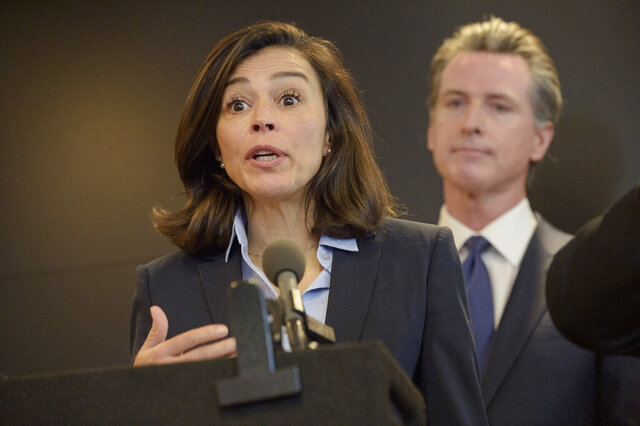 FILE - In this Feb. 27, 2020, file photo, California Department of Public Health Director and State Health Officer Dr. Sonia Angell speaks to members of the press at a news conference in Sacramento, Calif.. Angell announced she was departing from her role as director and state public health officer for the California Department of Public Health in a letter to staff that was released Sunday, August 9, 2020. (AP Photo/Randall Benton, File)