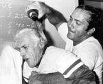 FILE - In this Sept. 21, 1976, file photo, Cincinnati Reds catcher Johnny Bench, right, pours champagne over Reds manager Sparky Anderson during the celebration in the clubhouse after the Reds won the National League Western Division title in Cincinnati. The Reds won back to back World Series in 1975-1976. (AP Photo/File)