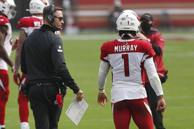 Arizona Cardinals head coach Kliff Kingsbury talks with quarterback Kyler Murray (1) during the second half of an NFL football game against the San Francisco 49ers in Santa Clara, Calif., Sunday, Sept. 13, 2020. (AP Photo/Josie Lepe)