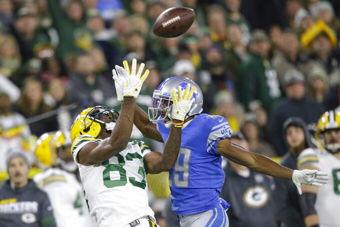 Green Bay Packers wide receiver Marquez Valdes-Scantling (83) catches a long pass while covered by Detroit Lions cornerback Rashaan Melvin during the second half of an NFL football game Monday, Oct. 14, 2019, in Green Bay, Wis. (AP Photo/Jeffrey Phelps)