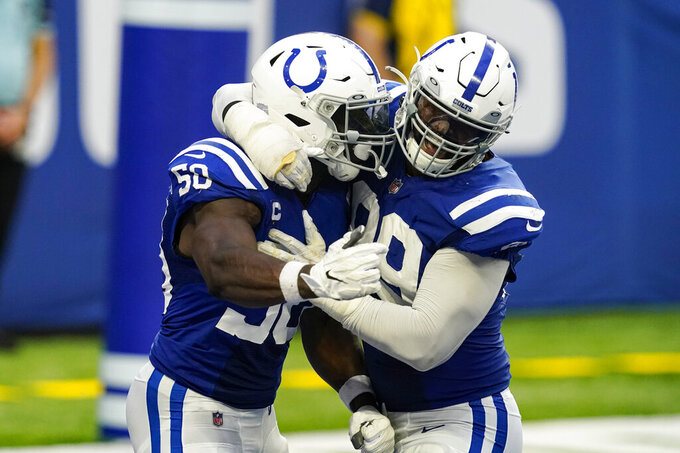 Indianapolis Colts defensive end Justin Houston (50) and defensive tackle DeForest Buckner (99) celebrates a safety against the New York Jets in the second half of an NFL football game in Indianapolis, Sunday, Sept. 27, 2020. (AP Photo/Darron Cummings)