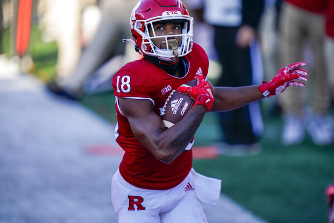 Rutgers wide receiver Bo Melton (18) scores a touchdown in the first quarter of an NCAA college football game against Indiana, Saturday, Oct. 31, 2020, in Piscataway, N.J. (AP Photo/Corey Sipkin)