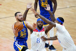 Golden State Warriors guard Stephen Curry (30) goes to the basket against New Orleans Pelicans forward Naji Marshall (8) and forward James Johnson in the first half of an NBA basketball game in New Orleans, Tuesday, May 4, 2021. (AP Photo/Gerald Herbert)