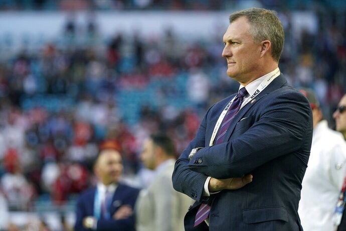 San Francisco 49ers general manager John Lynch watches his team warm up before the NFL Super Bowl 54 football against the Kansas City Chiefs Sunday, Feb. 2, 2020, in Miami. (AP Photo/David J. Phillip)