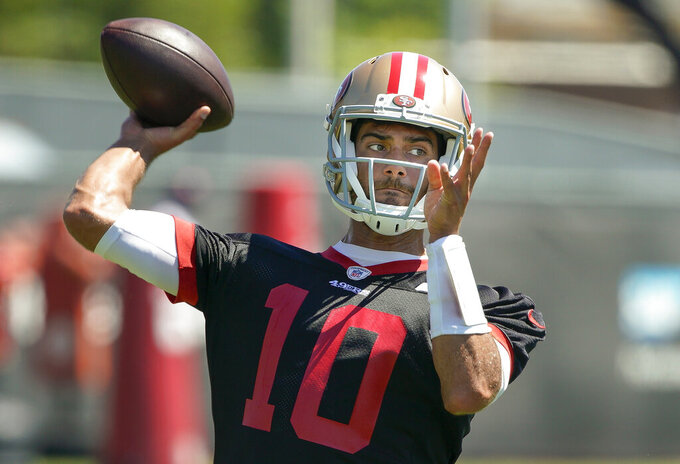 FILE - In this Tuesday, June 10, 2019 file photo, San Francisco 49ers quarterback Jimmy Garoppolo throws a pass during a drill at the team's NFL football training facility in Santa Clara, Calif. Jimmy Garoppolo had a practice to forget in his final session before facing an opposing defense for the first time since suffering a season-ending knee injury last September. Garoppolo threw interceptions on five straight pass attempts at practice for the San Francisco 49ers on Wednesday, Aug. 14, 2019 in by far his worst session in his return from the torn ACL that cut short his 2018 season after three games.(AP Photo/Tony Avelar, File)