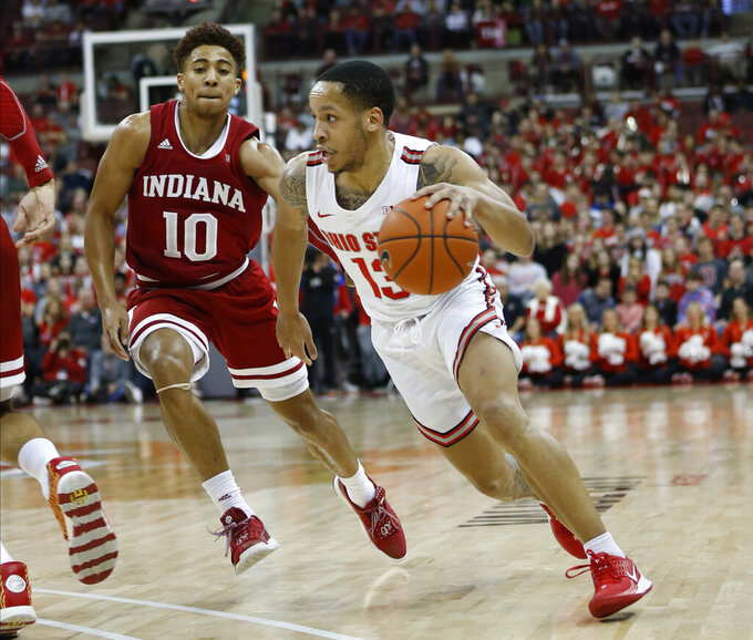 Ohio State's C.J. Walker, right, dribbles past Indiana's Rob Phinisee during the second half of an NCAA college basketball game Saturday, Feb. 1, 2020, in Columbus, Ohio. Ohio State beat Indiana 68-59. (AP Photo/Jay LaPrete)