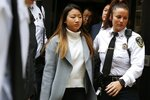 Inyoung You leaves Suffolk Superior Court in Boston, Friday, Nov. 22, 2019, after pleading not guilty to involuntary manslaughter. Prosecutors say You sent Alexander Urtula more than 47,000 text messages in the last two months of their relationship, including many urging him to