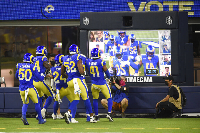 Los Angeles Rams players celebrate after an interception by Jalen Ramsey during the second half of an NFL football game against the Chicago Bears Monday, Oct. 26, 2020, in Inglewood, Calif. (AP Photo/Kelvin Kuo)