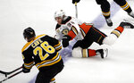 Anaheim Ducks right wing Jakob Silfverberg (33) competes with Boston Bruins center Colby Cave (26) for the puck in the first period of an NHL hockey game, Thursday, Dec. 20, 2018, in Boston. (AP Photo/Elise Amendola)