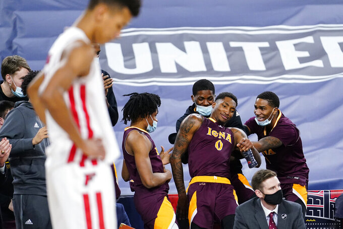 Iona's Berrick JeanLouis (0) celebrates with teammates in the final seconds of an NCAA college basketball game against Fairfield during the finals of the Metro Atlantic Athletic Conference tournament, Saturday, March 13, 2021, in Atlantic City, N.J. (AP Photo/Matt Slocum)