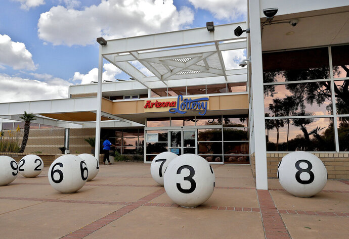 The Arizona lottery headquarters is shown Friday, April 12, 2019 in Tempe, Ariz. A growing number of states are moving to allow winners of big lottery jackpots to stay anonymous. It comes as privacy concerns are increasingly trumping lottery groups' wishes to publicize winners to boost sales and show that the games are fair. (AP Photo/Matt York)