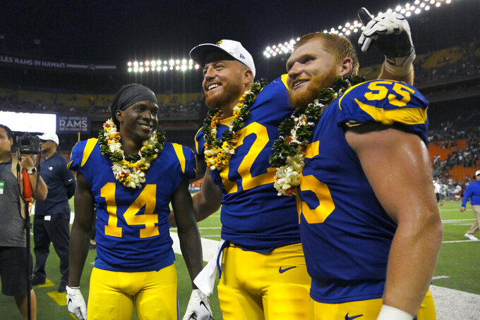 Los Angeles Rams, from left, Nsimba Webster, Aaron Neary and Ketner Kupp pose together after a preseason NFL football game against the Dallas Cowboys Saturday, Aug. 17, 2019, in Honolulu. The Cowboys won 14-10. (AP Photo/Mark J. Terrill)