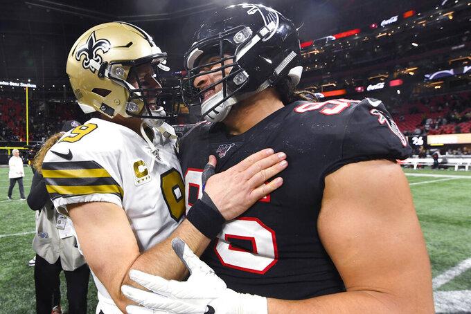 New Orleans Saints quarterback Drew Brees (9) speaks with Atlanta Falcons defensive tackle Tyeler Davison (96) after an NFL football game, Thursday, Nov. 28, 2019, in Atlanta. The New Orleans Saints won 26-18. (AP Photo/John Amis)
