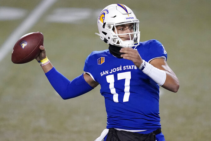 FILE - In this Friday, Dec. 11, 2020 file photo, San Jose State quarterback Nick Starkel (17) looks to throw against Nevada during the first half of an NCAA college football game  in Las Vegas. No. 25 San Jose State will face perennial conference powerhouse Boise State in the Mountain West championship on Saturday, Dec. 19, 2020 in Las Vegas. The game is usually played on the higher seed's home field but this year it will be held at Sam Boyd Stadium. (AP Photo/John Locher, File)