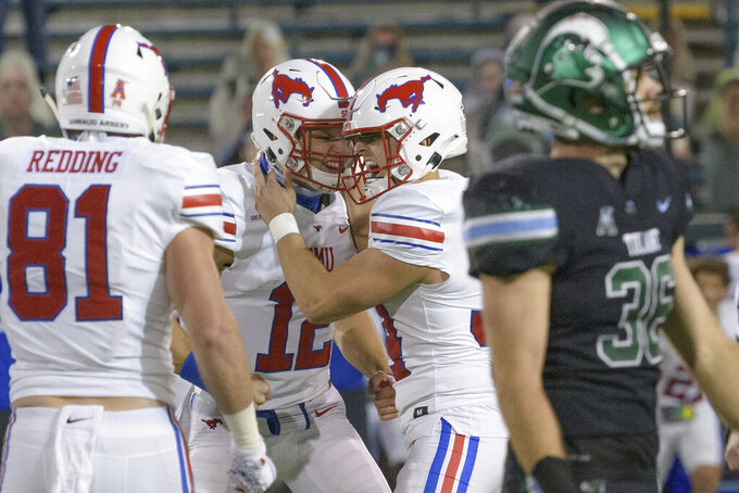 SMU placekicker Chris Naggar (34) celebrates with quarterback / holder Derek Green (12) after kicking the winning field goal in overtime to give his team a victory over Tulane in an NCAA college football game in New Orleans, Friday, Oct. 16, 2020. (AP Photo/Matthew Hinton)