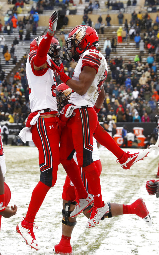 Utah wide receiver Jaylen Dixon, right, celebrates after catching a pass for a touchdown with wide receiver Solomon Enis in the second half of an NCAA college football game against Colorado, Saturday, Nov. 17, 2018, in Boulder, Colo. Utah won 30-7. (AP Photo/David Zalubowski)