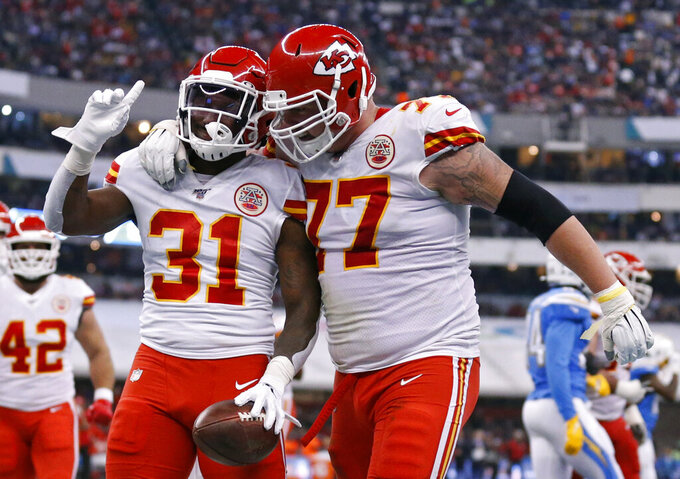 Kansas City Chiefs running back Darrel Williams (31) celebrates with teammate offensive guard Andrew Wylie after scoring a touchdown during the second half of an NFL football game against the Los Angeles Chargers, Monday, Nov. 18, 2019, in Mexico City. (AP Photo/Rebecca Blackwell)