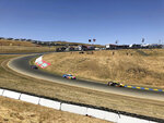 "Landon Cassill (00), Kyle Busch (18) and Clint Bowyer (14) drive into ""The Carousel"" at Sonoma Raceway during a NASCAR Cup Series practice Friday, June 21, 2019 in Sonoma. The track has put the tricky carousel turn back into its layout for the first time since 1997. (AP Photo/Greg Beacham)"