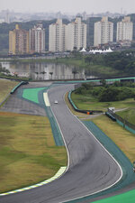 In this Nov. 7, 2019 photo, a vehicle drives on the Interlagos racetrack in Sao Paulo, Brazil. Now, to Sao Paulo's chagrin, Rio de Janeiro is pushing for an F1 racetrack, too. (AP Photo/Nelson Antoine)