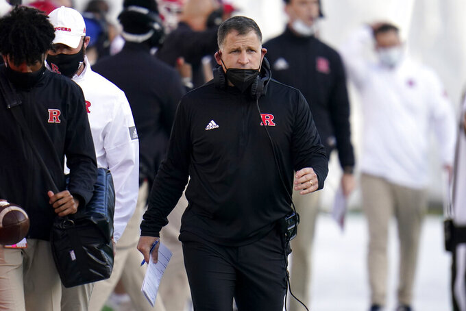 Rutgers head coach Greg Schiano looks on during the second half of an NCAA college football game against Maryland, Saturday, Dec. 12, 2020, in College Park, Md. Rutgers won 27-24 in overtime. (AP Photo/Julio Cortez)