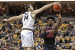 Georgia's Rayshaun Hammonds (20) passes around Missouri's Reed Nikko (14) during the first half of an NCAA college basketball game Tuesday, Jan. 28, 2020, in Columbia, Mo. (AP Photo/Jeff Roberson)