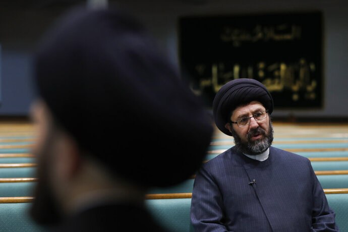 Imam Sayed Hassan Al-Qazwini speaks at the Islamic Institute of America, home of the Al-Hujjah Islamic Seminary, in Dearborn Heights, Mich., Oct. 1, 2019. Al-Hujjah is the newest of several seminaries focused on the Shiite branch of Islam in the United States and Canada working to address a shortage of leaders as an increasing number of U.S. Muslims seek guidance from people who speak their primary language and experience their culture. (AP Photo/Paul Sancya)