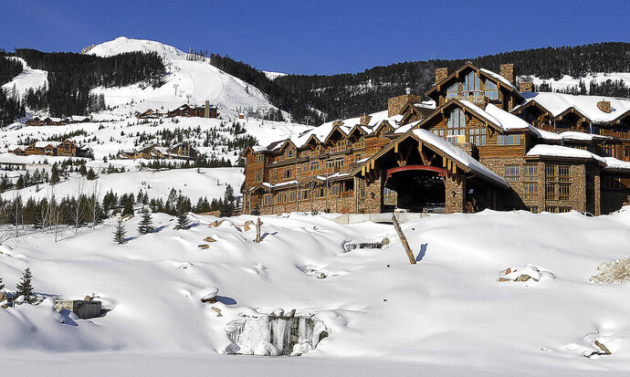 FILE - This undated file photo shows the Yellowstone Club near Big Sky, Mont. Montana officials won't pull the liquor licenses from the ultra-exclusive ski resort that counts Bill Gates and Justin Timberlake among its members as part of a $370,000 settlement agreement with Yellowstone Club officials that include a major campaign donor to Gov. Steve Bullock. (Erik Petersen/Bozeman Daily Chronicle via AP, File)
