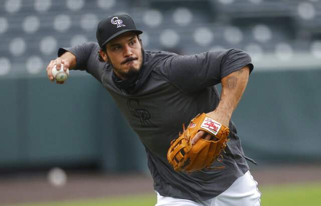 Colorado Rockies third baseman Nolan Arenado takes part in drills during the baseball team's practice Sunday, July 12, 2020, in Denver. (AP Photo/David Zalubowski)