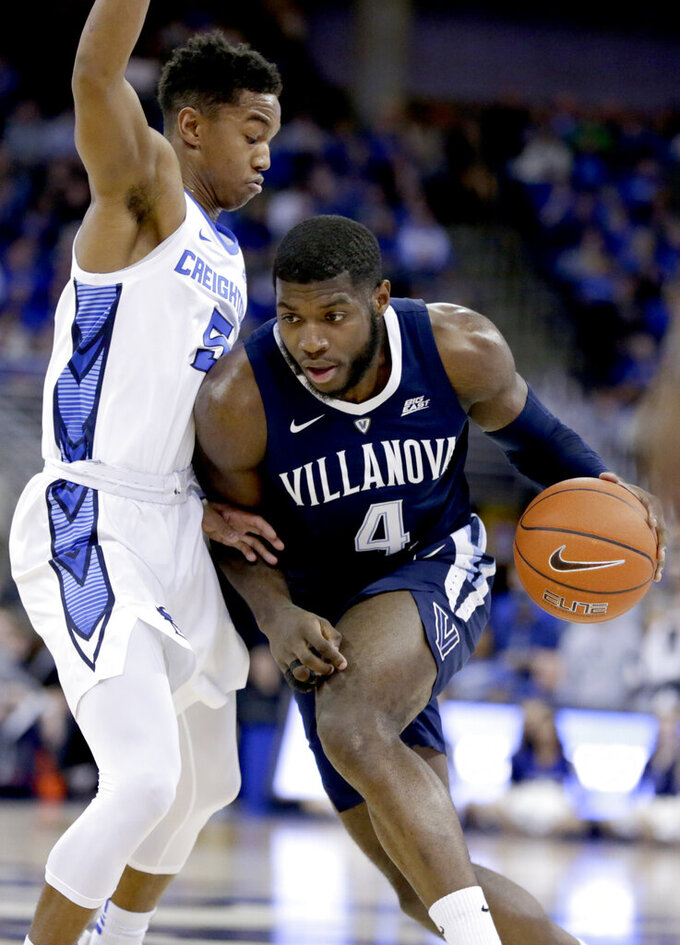Villanova's Eric Paschall (4) drives to the basket around Creighton's Ty-Shon Alexander (5) during the first half of an NCAA college basketball game in Omaha, Neb., Sunday, Jan. 13, 2019. (AP Photo/Nati Harnik)