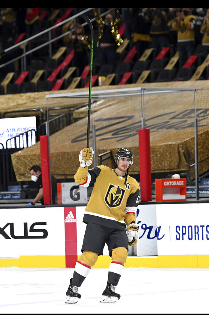 Vegas Golden Knights right wing Reilly Smith skates on the ice after being name the first star of an NHL hockey game, in which he scored three goals against the St. Louis Blues on  Saturday, May 8, 2021, in Las Vegas. (AP Photo/David Becker)