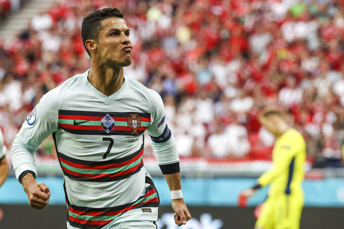 Portugal's Cristiano Ronaldo celebrates after scoring his second team goal during the Euro 2020 soccer championship group F match between Hungary and Portugal at the Ferenc Puskas stadium in Budapest, Hungary, Tuesday, June 15, 2021. (Bernadett Szabo/Pool via AP)