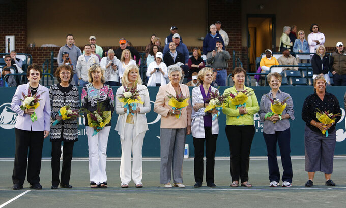 FILE - In this April 7, 2012, file photo, members of the original nine women, from left to right, Billie Jean King, Peaches Bartkowicz, Kristy Pigeon, Valerie Ziegenfuss, Judy Tegart Dalton, Julie Heldman, Kerry Melville Reid, Nancy Richey and Rosie Casals, who helped start the women's professional tennis tour are honored at the Family Circle Cup tennis tournament in Charleston, S.C. Billie Jean King and the other members of the Original 9 who laid the groundwork for the women's professional tour are the first group elected together to the International Tennis Hall of Fame, joining Lleyton Hewitt and Dennis Van der Meer in the Class of 2021. In results announced Wednesday, Feb. 24, 2021. (AP Photo/Mic Smith, File)