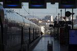 A railway employee stands next to a high-speed train at the Gare St-Charles station in Marseille, southern France, Sunday, Dec. 8, 2019, on the fourth day of nationwide strikes that disrupted weekend travel around France.  (AP Photo/Daniel Cole)