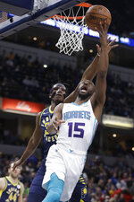 Charlotte Hornets' Kemba Walker, right, puts up a shot against Indiana Pacers' Myles Turner, left, during the first half of an NBA basketball game, Monday, Feb. 11, 2019, in Indianapolis. (AP Photo/Darron Cummings)