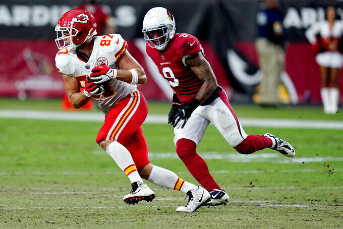 Kansas City Chiefs tight end Travis Kelce (87) makes the catch as Arizona Cardinals linebacker Isaiah Simmons (9) defends during the first half of an NFL football game, Friday, Aug. 20, 2021, in Glendale, Ariz. (AP Photo/Ross D. Franklin)