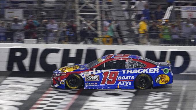 Martin Truex Jr., crosses the finish line to win the NASCAR Cup series auto race in Richmond, Va., Saturday, Sept. 11, 2021. (AP Photo/Steve Helber)