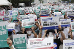 Interns and resident doctors hold up cards during a rally against the government medical policy in Seoul, South Korea, Friday, Aug. 7, 2020. Thousands of young doctors in South Korea began a strike Friday in protest of government medical policy, causing concerns about treatment of patients amid the coronavirus pandemic. The signs read:
