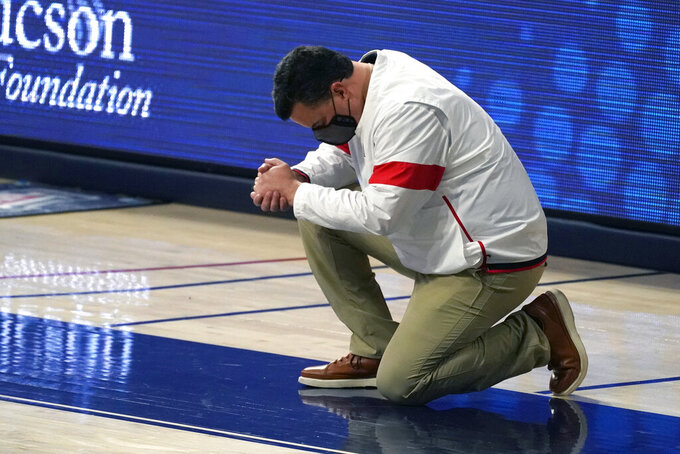 Arizona coach Sean Miller reacts after a play during the second half of the team's NCAA college basketball game against Southern California, Thursday, Jan. 7, 2021, in Tucson, Ariz. (AP Photo/Rick Scuteri)