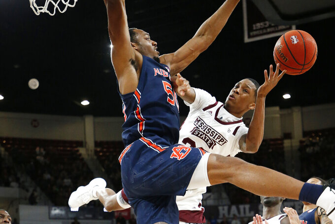 Auburn center Austin Wiley (50) blocks a shot attempt by Mississippi State guard Tyson Carter (23) during the first half of an NCAA college basketball game, Saturday, Jan. 4, 2020 in Starkville, Miss. (AP Photo/Rogelio V. Solis)