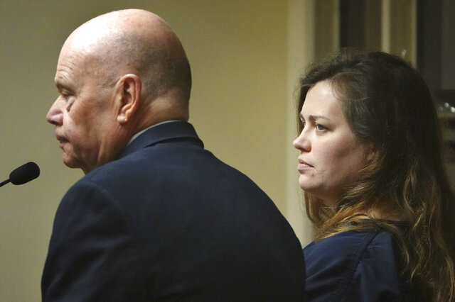 Hannah Roemhild, right, who is accused of driving through checkpoints outside President Donald Trump's Florida home Mar-a-Lago, listens during her initial appearance hearing, Monday, Feb. 3, 2020, West Palm Beach, Fla. (Joe Cavaretta/South Florida Sun-Sentinel via AP)