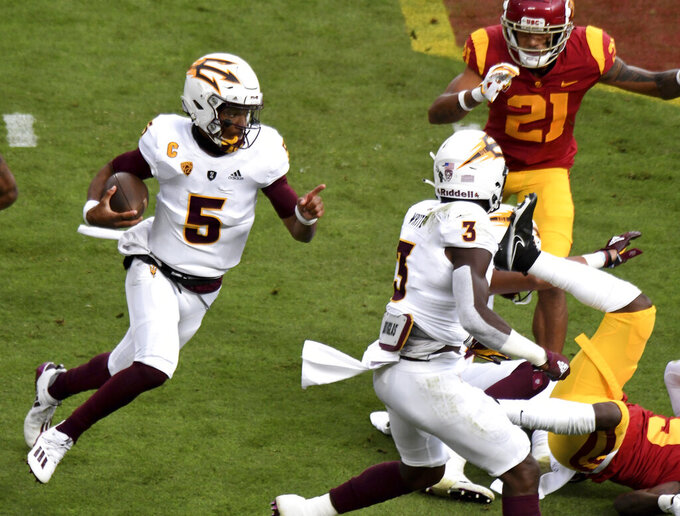 Quarterback Jayden Daniels #5 of the Arizona State Sun Devils scrambles against USC Trojans in the first half of a NCAA football game at the Los Angeles Memorial Coliseum in Los Angeles on Saturday, November 7, 2020. (Keith Birmingham/The Orange County Register via AP)
