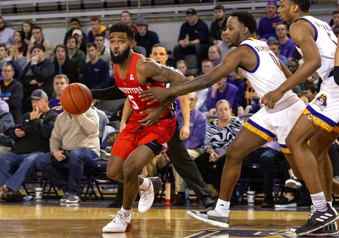 Houston's Corey Davis Jr. (5) dribbles around East Carolina's Isaac Fleming (0) during the second half of an NCAA college basketball game in Greenville, N.C., Wednesday, Feb. 27, 2019. (AP Photo/Ben McKeown)
