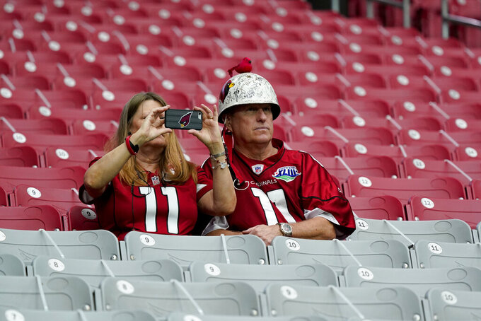 A limited number of Arizona Cardinals fans sit in the stands prior to an NFL football game against the Detroit Lions, Sunday, Sept. 27, 2020, in Glendale, Ariz. (AP Photo/Ross D. Franklin)