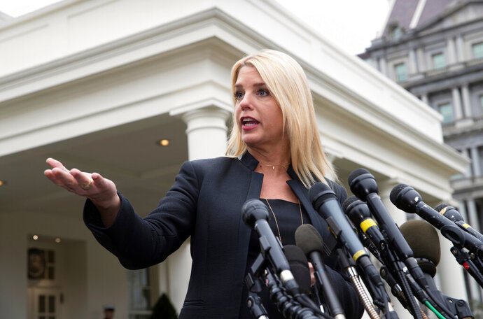 FILE - In this Thursday, Feb. 22, 2018 file photo, Florida Attorney General Pam Bondi speaks to reporters outside the West Wing of the White House in Washington, after meeting with President Donald Trump about about responses to school shootings. Bondi is preparing to defend Trump against accusations that he pressured a foreign government to aid his re-election campaign. And she's stepping down from a lobbying where she represented foreign interests (AP Photo/J. Scott Applewhite, File)