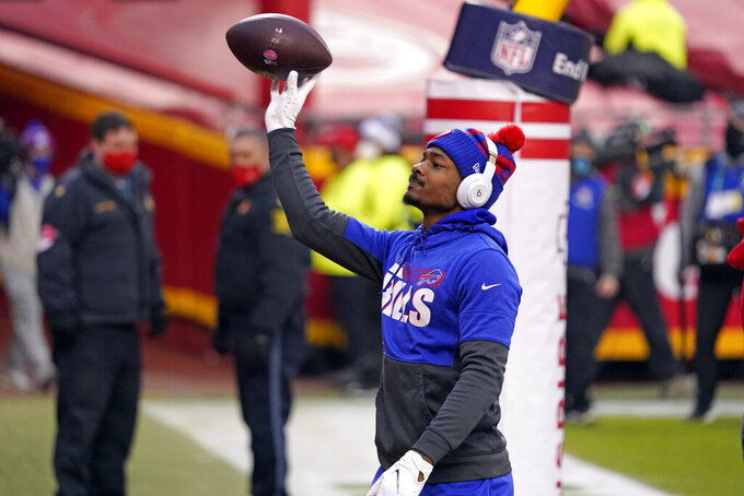Buffalo Bills wide receiver Stefon Diggs tosses a football to fans in the stands before the AFC championship NFL football game against the Kansas City Chiefs, Sunday, Jan. 24, 2021, in Kansas City, Mo. (AP Photo/Jeff Roberson)